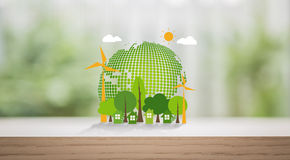 Eco friendly earth on wood Stock Photos