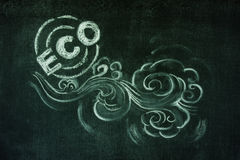 Eco friendly. Emblem with clouds and air illusrated with chalk on blackboard background Stock Photography