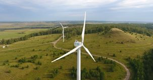 Eco-friendly energy. Aerial shot of wind generator in Russia. Windmill or wind power technology concept. Electric power