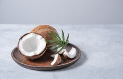 Free Eco Friendly Flat Lay. Fresh Coconut And Slices In Wooden Plate  On Blue  Background. Healthy And Vegan Food. Front  View And Copy Stock Images - 221470154