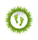 Eco Friendly Footprints on Green Grass Royalty Free Stock Photos