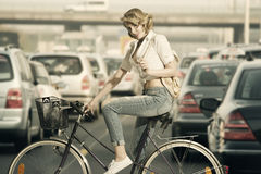 Eco-friendly girl on a bicycle Stock Photo