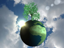 Eco-friendly globe. 3D potho realistic globe on a sky background. Many metaphorical uses Royalty Free Stock Photo