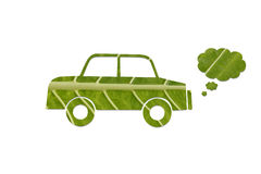 Eco friendly green car. A green leaf cutout of a car with smoke emission symbolizing eco friendly transportation royalty free stock images