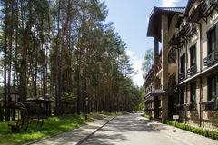 Eco-friendly hotel. Eco-friendly resort hotel in forest Royalty Free Stock Images