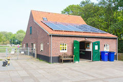 Eco Friendly House. Eco Friendly Petting Zoo House with Solar Cells on the Roof, The Hague, Netherlands Stock Photography