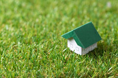 Eco friendly house. Green and eco friendly house on the grass, for real estate concept Stock Image