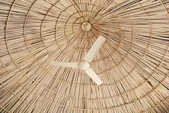 Eco Friendly House. Round pyramid type ceiling made of bamboo sticks of a eco friendly house with electric fan Royalty Free Stock Photo