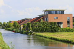 Eco Friendly Houses with Natural Grass Roofs. Dutch Eco Friendly houses with Grass Roof at Hoorn, North of Amsterdam, Netherlands Royalty Free Stock Photo