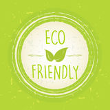 Eco friendly with leaf sign in circle over green old paper backg Stock Photography