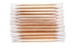 Eco-friendly materials. Wooden, cotton swabs on a white background stock photo