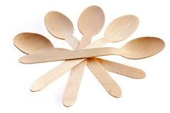 Eco-friendly materials. Wooden, disposable spoon on a white background royalty free stock images