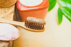 Eco friendly natural bamboo toothbrush place on wooden plates and toothpaste made from salt,charcoal and Aloe,concept reduce use. Plastic for Sustainable health stock image