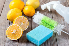 Eco-friendly natural cleaners baking soda, lemon and cloth on wooden table. Eco-friendly natural cleaners baking soda, lemon and cloth n Stock Photos