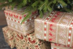 Eco-friendly New Year gifts under a fir tree Stock Photo