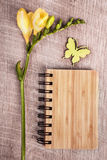 Eco-friendly notebook on the wooden table with flower Stock Photography