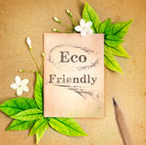 Eco friendly paper sheet with fresh spring  green leafs and flow Stock Images