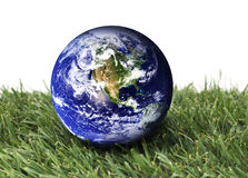 Eco Friendly. Planet earth over green grass on a isolated background Royalty Free Stock Photography
