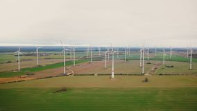 Eco-friendly power industry, scenic aerial background shot of large windmill turbine farm working in autumn field. stock footage