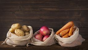 Eco friendly reusable net bags. With fruits and vegetables stock image