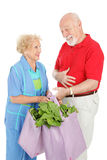 Eco-friendly Senior Shoppers Stock Photography