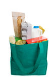 Eco friendly shopping. Green eco friendly grocery bag full of food Stock Photos