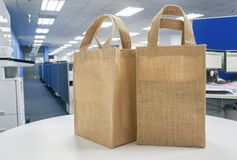 Eco-friendly shopping bags on white table. In office Stock Photo
