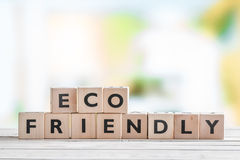 Eco friendly sign on a table Royalty Free Stock Image