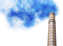 Eco Friendly Smoke Stack with Clouds. An isolated  smoke stack has bright blue clouds coming out of it instead of dirty polluted smoke. Use this to represent Stock Image