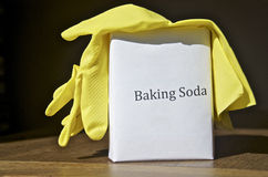 Eco- friendly Spring cleaning product. A box of baking soda and yellow rubber gloves are ready to start spring cleaning Stock Images