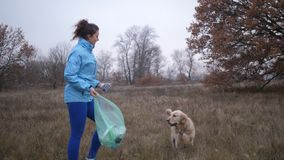 Eco friendly woman picking up litter outdoors stock video