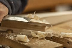 Chisel working and sawdust. Woodworking lifestyle, organic eco friendly design elements. Eco-friendly woodworker`s shop. Details and focus on the texture of the royalty free stock photography