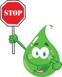 Eco Green Drop Character Holding A Stop Sign Royalty Free Stock Photo