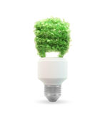 Eco and green energy bulb. Eco and green energy concept illustration - leaf covered bulb Stock Photo