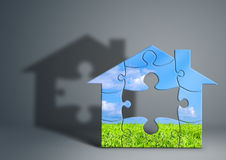 Eco green house concept, home made from puzzle on grey. Eco green house concept, home from puzzle on grey Stock Image