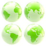 Eco green planet: set of four glossy globes Royalty Free Stock Photos