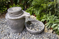 Eco green room zen garden. Beautiful indoor zen garden in the waiting room of Taipei Taoyuan International Airport, Taiwan. Chinese stone flour or grain grinder Royalty Free Stock Photo