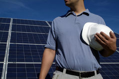 Eco green solar construction job. Eco friendly green sustainable business developer: construction worker with hard hat with renewable energy of solar panels stock photos