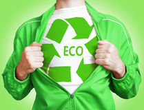 Eco hero. Man pulling open shirt showing sign recycle Stock Photos