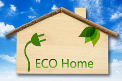 Eco home. Eco home on Little home wooden model on blue sky background Royalty Free Stock Photography