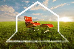 Eco House. Comfortable seat in meadow for Eco house concept Stock Photos