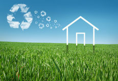 Eco house. In the grass, recycle concept Royalty Free Stock Image