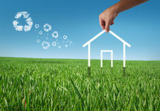 Eco house. In the grass, recycle concept Royalty Free Stock Photography