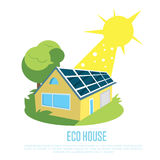 Eco house with blue solar panels on the roof. Stock Photo