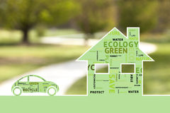 Eco house and car on blurred background Stock Photo