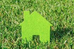 Eco house concept in green grass, green eco house icon in nature Stock Image