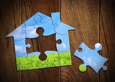 Eco house concept, home made from puzzle. Eco house concept, home from puzzle Royalty Free Stock Images