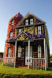 Eco house covered with flowers Royalty Free Stock Photos