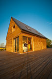 Eco house in field Stock Image