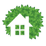 Eco house and green leaves Stock Photo
